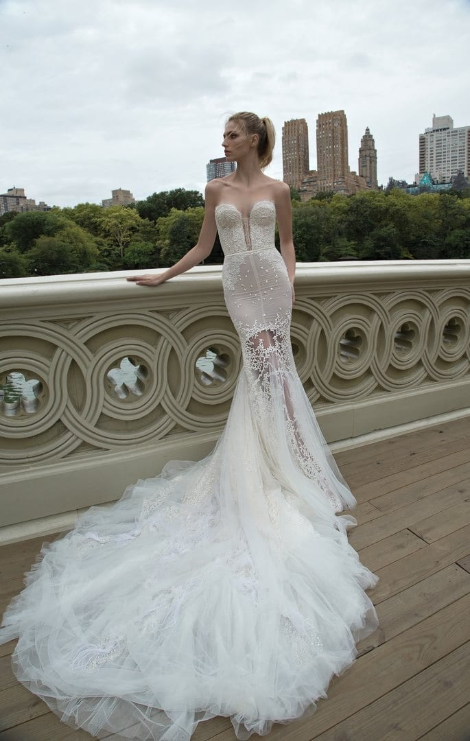 This stunning Inbal Dror dress is showing the latest in bridal fashion trends, feathers! View more at Morgan Davies Bridal.